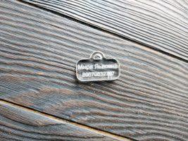An acrylic dog's tag