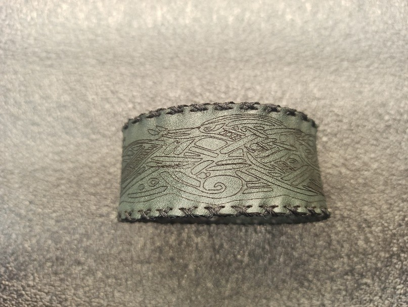 A leather bracelet with an ornament in a Scandinavian style.